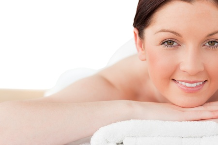 Attractive red-haired woman posing while relaxing in a spa centre photo