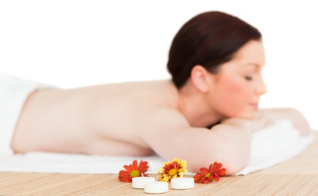 Young good looking red-haired female relaxing in a spa centre photo