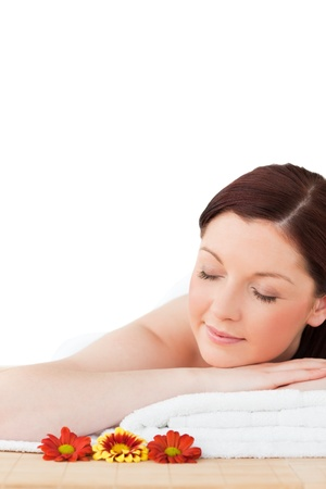 wellness center: Portrait of a happy red-haired woman posing while relaxing in a spa centre