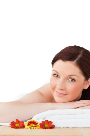 Portrait of a young red-haired woman posing while relaxing in a spa centre photo