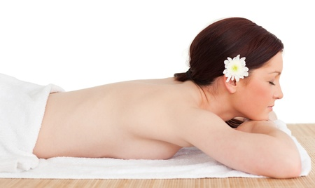 Portrait of a pretty serene woman posing while relaxing in a spa centre photo