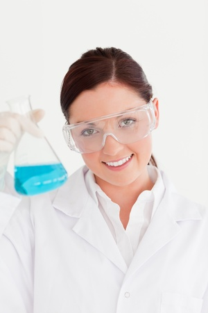 Cute scientist looking at the camera in a laboratory photo