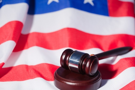 US flag and brown gavel photo