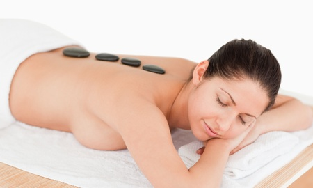young woman relaxing with a stone massage in a spa Stock Photo - 10070310
