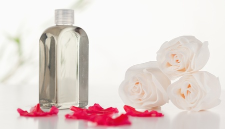 Glass flask with petals and roses Stock Photo - 10069630