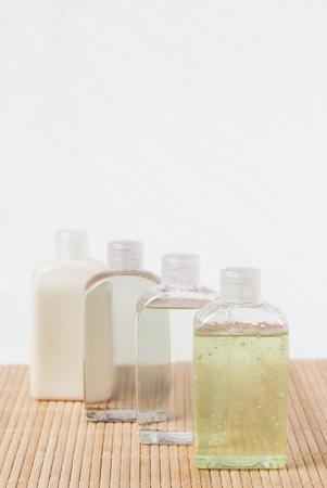 Four massage oil bottles photo