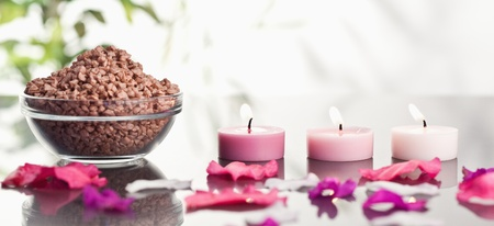 Pink petals with lighted candles and a bowl of brown gravel Stock Photo - 10070807