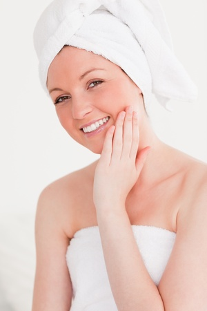 Good looking young woman wearing a towel against a white background photo