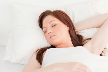 Close-up of an attractive red-haired female sleeping in her bed Stock Photo - 10070979