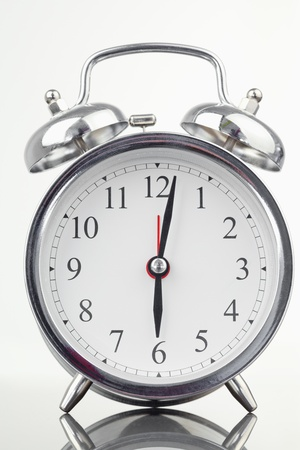Alarm clock isolated against a white background photo