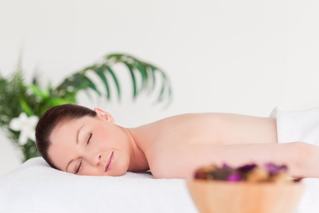 Young woman waiting for a massage photo