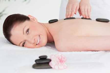 Beautiful woman having a LaStone therapy photo