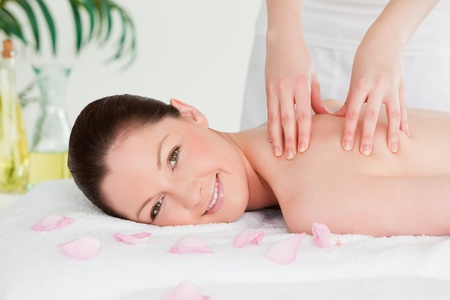 Redhead having a massage in a spa photo