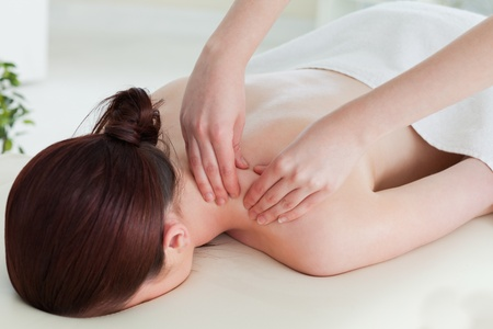 Red-haired woman having a rolling massage photo