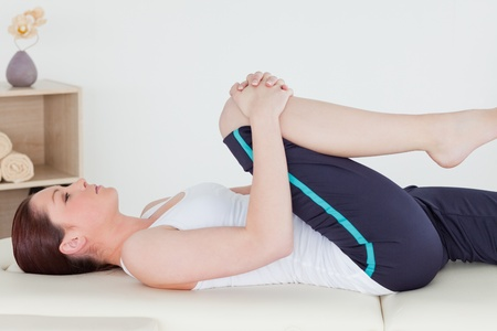 strength therapy: Sportswoman stretching her leg