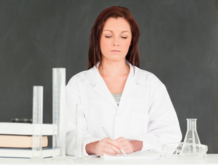 Seus scientist taking notes in a classroom Stock Photo - 10071849
