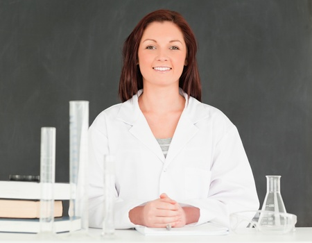 Smiling scient looking at the camera in a classroom Stock Photo - 10071858