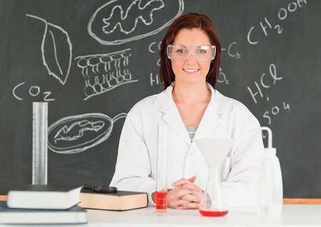 Happy young scientist looking at the camera in a classroom Stock Photo - 10074404
