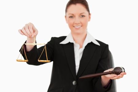 Young woman holdind the justice symbols against a white background Stock Photo - 10069632