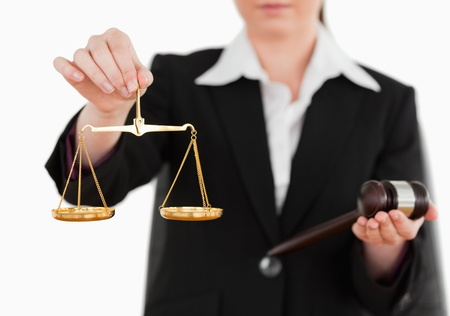 appraise: Woman holding a gavel and scales of justice against a white background Stock Photo