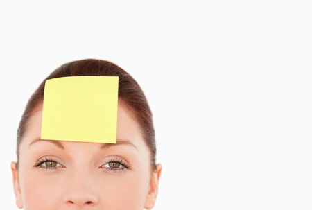 Young woman with a sign on her forehead against a white background Stock Photo - 10069587