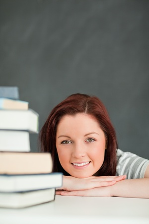 Portrait of a happy student in a classroom Stock Photo - 10074521