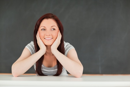 Smiling student in a classroom Stock Photo - 10074480