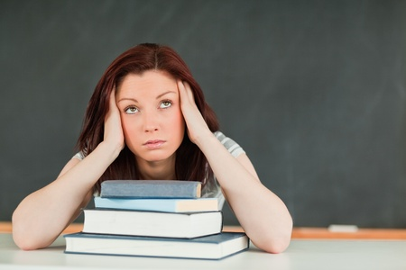 Tired young female student in a classroom Stock Photo - 10074664