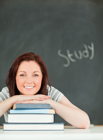 Portrait of a smiling young woman studying in a classroom Stock Photo - 10074369