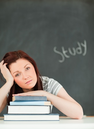 Potrait of a tired young woman studying in a classroom Stock Photo - 10074368