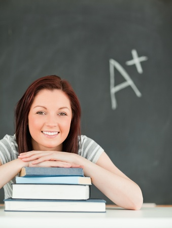 Portrait of a studious young woman in a classroom Stock Photo - 10074276