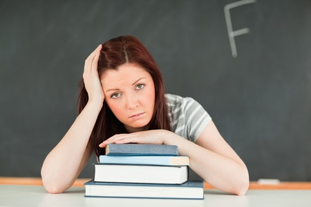 Sad young student receiving bad mark in a classroom Stock Photo - 10074566