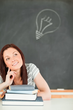 Clever young student in a classroom Stock Photo - 10074539