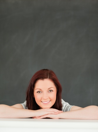 Portrait of a young woman in a classroom photo