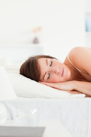 Lovely brunette female having a rest while lying on a bed Stock Photo - 10070325