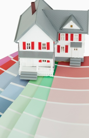 A maniature house on a color chart against a white background Stock Photo - 10070336