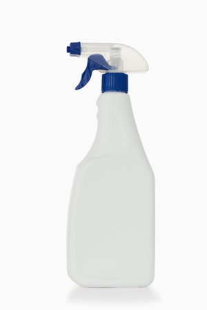 Blue spray bottle against a white background photo