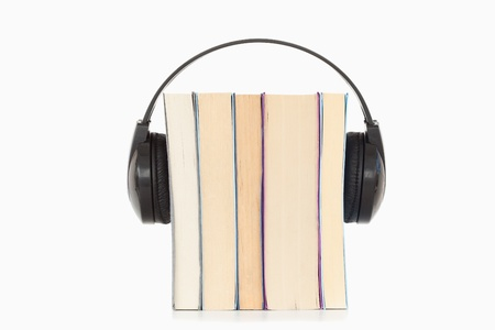 Some books and headphones against a white background photo