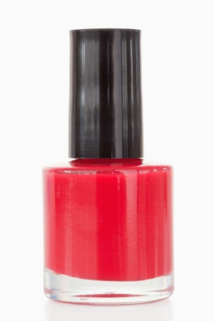 Red nail polish against a white background photo