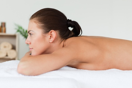 Brunette waiting for a massage in a spa photo