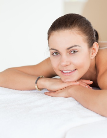 Portrait of a woman lying on a massage table in a spa photo