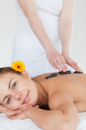 Portrait of a woman enjoying a hot stone massage in a spa Stock Photo - 10071843