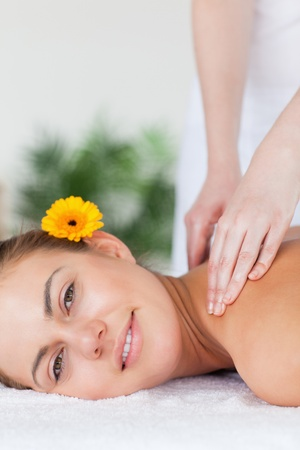 Portrait of a beautiful woman having a shoulder massage in a spa Stock Photo - 10074199