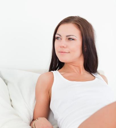Brunette posing  in a bebroom photo