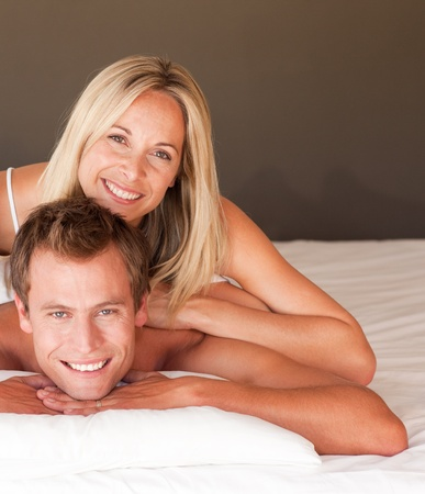 Young couple having fun together lying on bed Stock Photo - 10074886