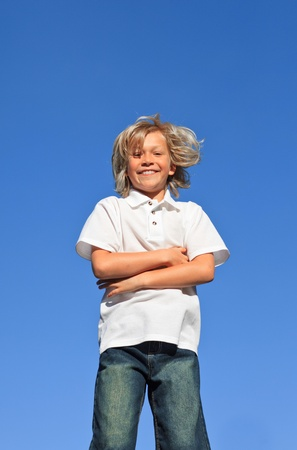 Confident Kid with arms folded having fun outdoor  photo