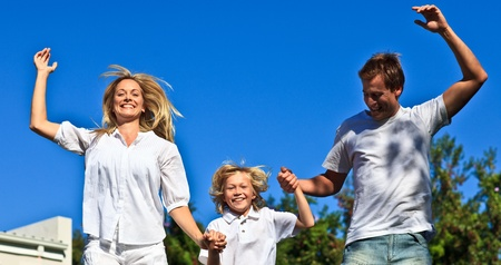 Happy caucasian Family Playing in the garden Stock Photo - 10075118