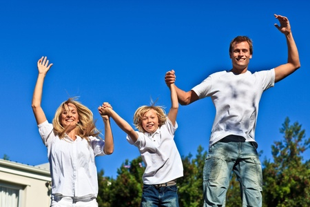 Smiling caucasian Family Playing in the garden  Stock Photo - 10075171