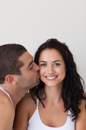 Man kissing his beautiful girlfriend photo