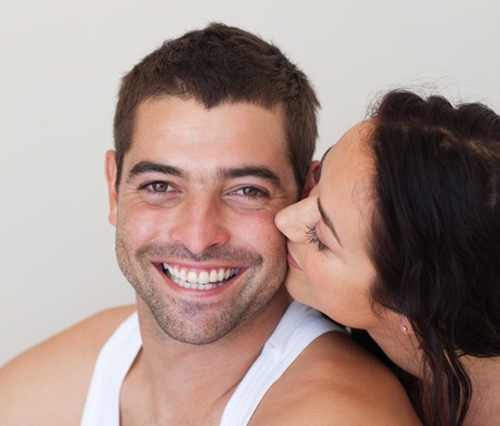 Close-up of girlfriend kissing her boyfriend  photo